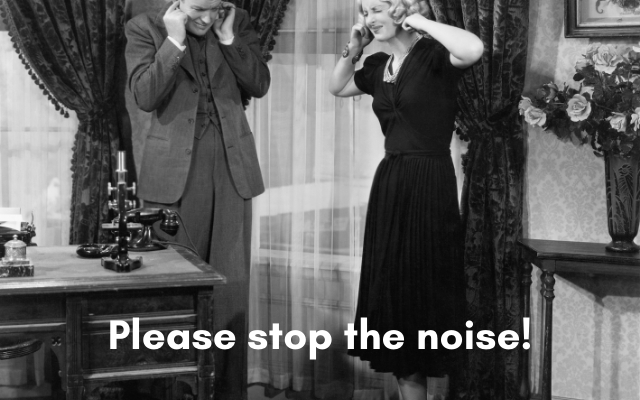 a couple closing their ears with both hands to avoid the noise enter their ears