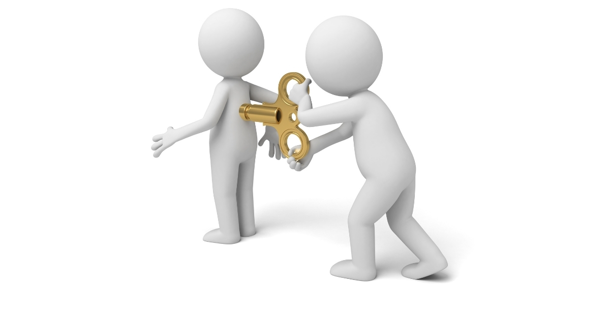a person controlling another person by turning the key